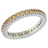 Orange sapphire white gold eternity ring